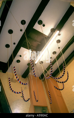 Bell ropes inside a belfry - Stock Photo