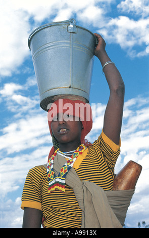 Woman carrying water container on her head in Harer Ethiopia - Stock Photo