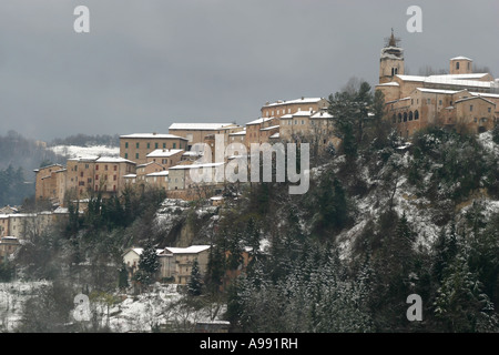 Historic hill town of Amandola in Le Marche Italy dusted with winter snow - Stock Photo