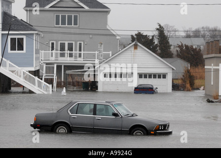 A flooded car during a storm - Stock Photo