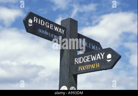 A signpost on the ridgeway national trail showing access as both footpath and bridleway - Stock Photo
