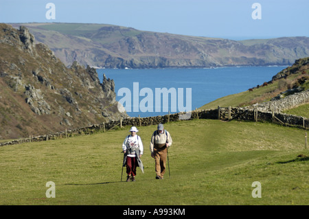 Walkers above Starehole Bay at the entrance to Salcome Harbour near Bolt Head on the South West Coast in south Devon - Stock Photo