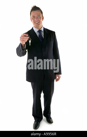 Businessman holding out a set of keys - Stock Photo