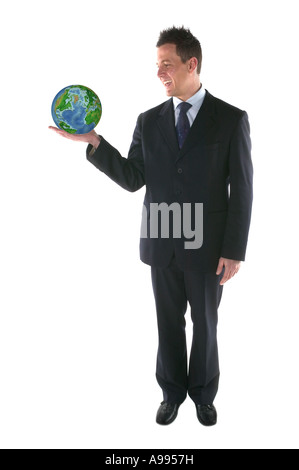 Businessman smiling at a globe in his hand isolated on white - Stock Photo