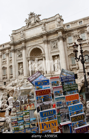 The Trevi Fountain viewed over a souvenir stall in Rome, Italy - Stock Photo