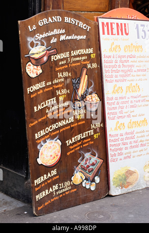 Restaurant menu board in front of a restaurant in Paris, France - Stock Photo
