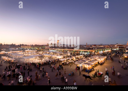 Panoramic view over the open air food stalls in the  central square of Djemaa El Fna in Marrakesh  Morocco - Stock Photo