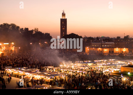Koutoubia mosque in the central square of Djemaa El Fna in Marrakesh Morocco - Stock Photo