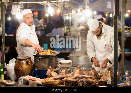 Food stall vendor preparing baked sheep head and brain on the central square of Djemaa El Fna in Marrakesh - Stock Photo