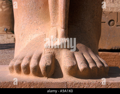 Feet of Ramses II and his wife at Temple of Karnak Egypt - Stock Photo