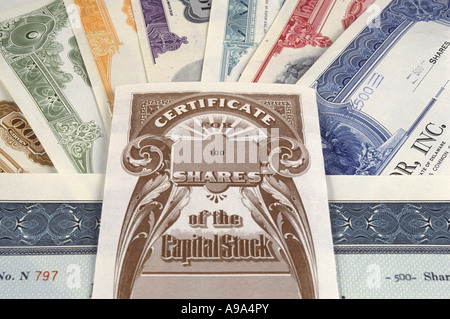 PILE OF STOCKS AND  BOND CERTIFICATES - Stock Photo
