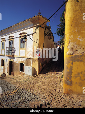 Old style Portuguese houses in a cobbled street in the town of Silves Algarve Portugal - Stock Photo