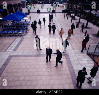 Office workers on concourse at Canary Wharf London UK Britain England United Kingdom - Stock Photo