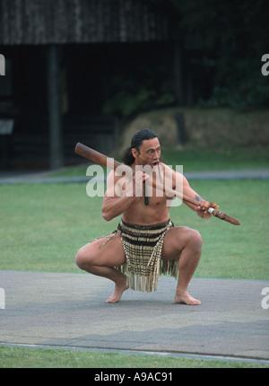 Maori warrior at the traditional welcoming ceremony preparing for the haka in Rotorua North Island New Zealand - Stock Photo