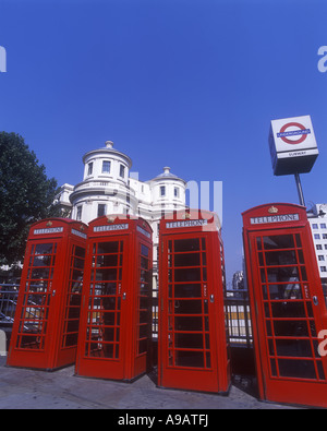 LINE OF CLASSIC RED TELEPHONE BOXES STRAND LONDON ENGLAND UK - Stock Photo