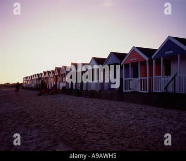 Row of beach huts along the beach at Southwold, Suffolk, UK - Stock Photo