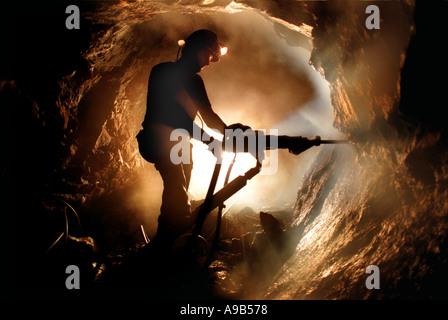 A Cornish tin miner at work at the old Geevor Tin Mine near Camborne, Cornwall, UK - Stock Photo