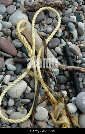 Flotsam left at high tide mark on a Scottish beach. - Stock Photo