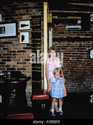 Children standing next to the flood level indicator in the King's Arms, Kings Staithe, City of York, North Yorkshire, - Stock Photo