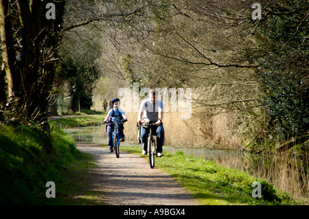 Cyclists on towpath of restored section the Crumlin Arm of Monmouthshire and Brecon Canal Newport South Wales UK - Stock Photo