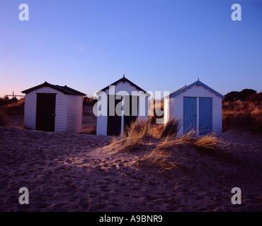 Three beach huts along the beach at Southwold, Suffolk,  UK - Stock Photo