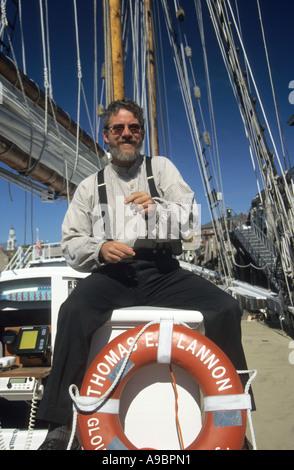 Storyteller entertains day cruise passengers on board the 65ft schooner Thomas E. Lannon out of Gloucester Massachusetts - Stock Photo