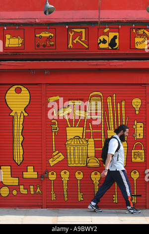 A do it yourself diy shop small business in town stock photo man walking past a do it yourself shop in finsbury park london uk solutioingenieria Image collections