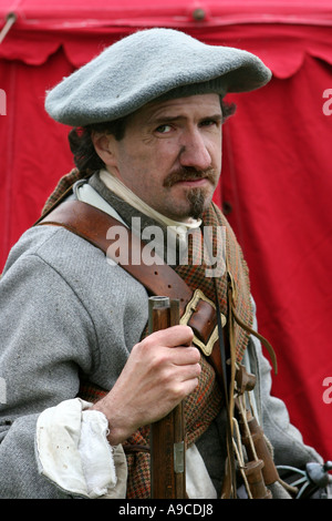 Musketeer dressed in colourful historical period costume of The Sealed Knot Society, Scotland, UK, - Stock Photo