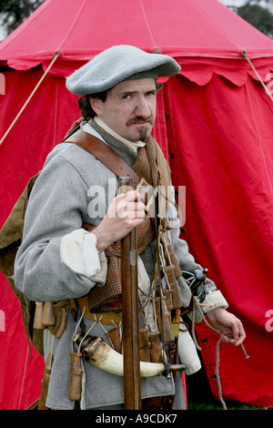 Rifleman in historical period costumes of The Sealed Knot Society, holding medieval musket. - Stock Photo