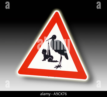 give way sign with stork,, close-up - Stock Photo