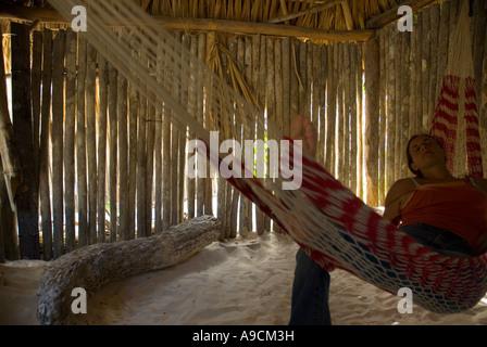 tulum caribbean woman inside a cabana hut lying in a hammock mexico   stock photo tulum caribbean woman inside a cabana hut lying in a hammock stock      rh   alamy