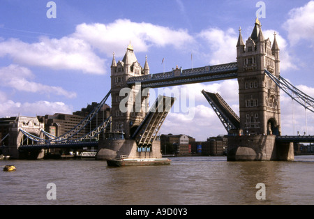 View Tower Bridge the middle splits & lifts up to allow tall ships to pass through River Thames London England UK - Stock Photo