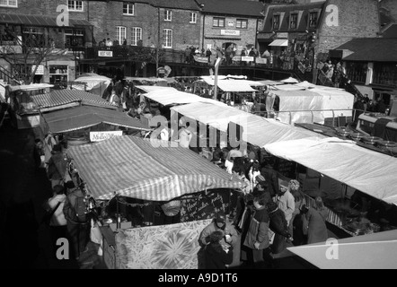 View of busy lively colourful shops & stands Camden Lock Market Camden Town London England United Kingdom Europe - Stock Photo