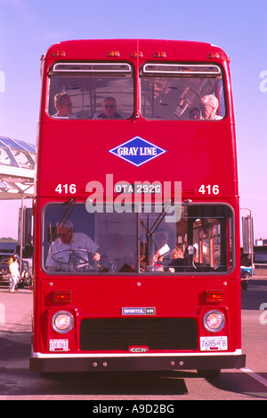 Red Double Decker Bus carrying Sightseeing Tourists on Tour, Vancouver, BC, British Columbia, Canada - Stock Photo