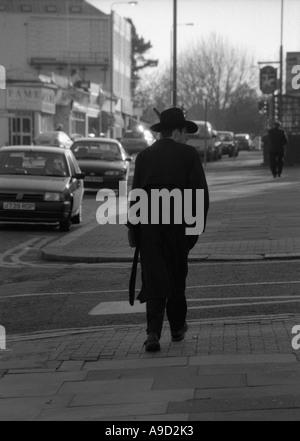 Jewish man walking in High Street in Golders Green home large Jewish Community London England United Kingdom Europe - Stock Photo