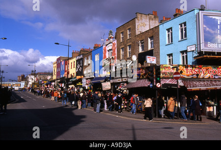 View of busy lively colourful street & shops in Camden Town London England United Kingdom Europe - Stock Photo