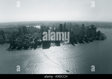 New York City harbor harbour Lower Manhattan downtown and Hudson River aerial photo in spring sun sunshine New York - Stock Photo