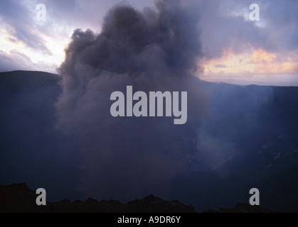 Small volcanic explosion at the crater peak of Mount Yasur Volcano on Tanna Island in the Vanuatu Island Group, - Stock Photo