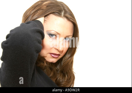 Young Woman With Hand In Hair Looking Into Camera With A Hateful Look - Stock Photo