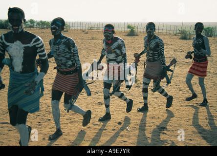 Men dancing at Omorate shanty village Omo region Ethiopia - Stock Photo