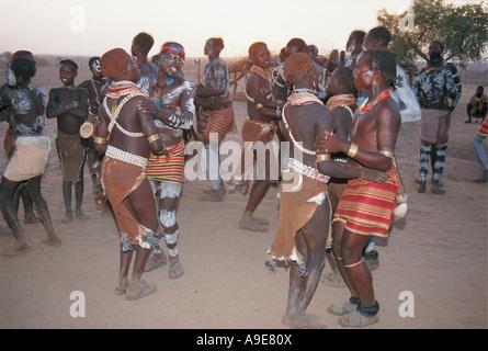 Karo tribe dancing on banks of the Omo river Ethiopia - Stock Photo
