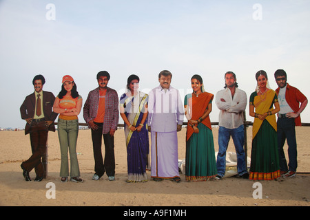 Visitors have their photograph taken with cutout famous Indian celebrities on Chennai beach (Madras), Tamil Nadu, - Stock Photo