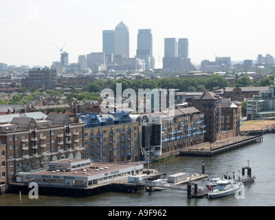 Aerial view looking down on River Thames & Tower Hamlets riverside buildings with Canary Wharf Dockland redevelopment - Stock Photo
