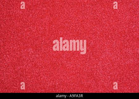 Red velvet fabric, full frame, close-up - Stock Photo