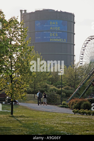 view from the park of the CentrO to the Gasometer, Germany, North Rhine-Westphalia, Ruhr Area, Oberhausen - Stock Photo