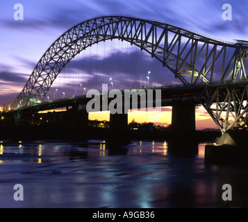 The Runcorn and Widnes Roadbridge Over the River Mersey at Night, Cheshire, England, UK - Stock Photo