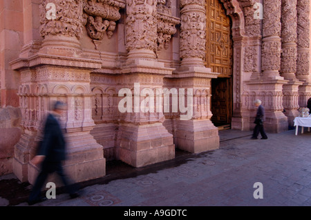 Pedestrians in front of ornate churrigueresque style columns on the main Cathedral in Zacatecas city Zacatecas Mexico - Stock Photo