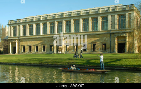 Punt on the River Cam passing the Wren Library of Trinity College Cambridge - Stock Photo