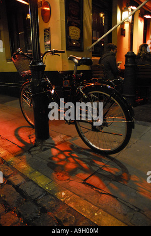 Bicycle outside pub in London - Stock Photo