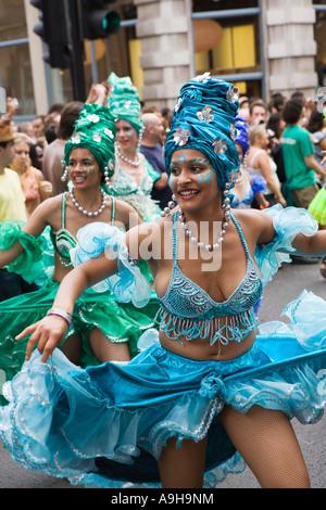 Costumed Carnival dancers in London - Stock Photo